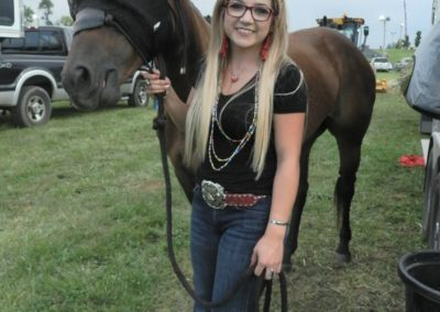 Barrel racer with horse