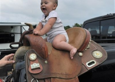 Baby on mother's horse